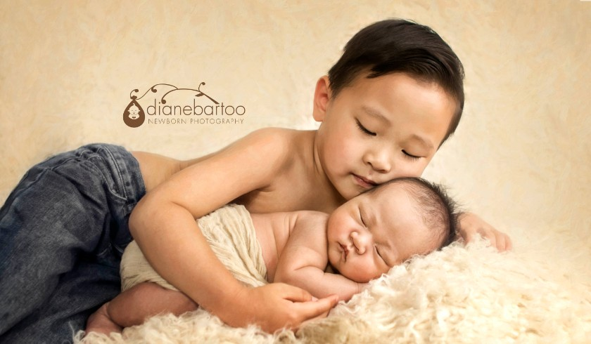 newborn boy with brother photo riverside