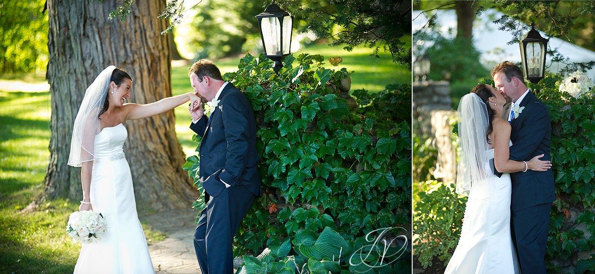 bride kissing groom photo, wedding ceremony photo, riverstone manor, schenectady wedding photographer