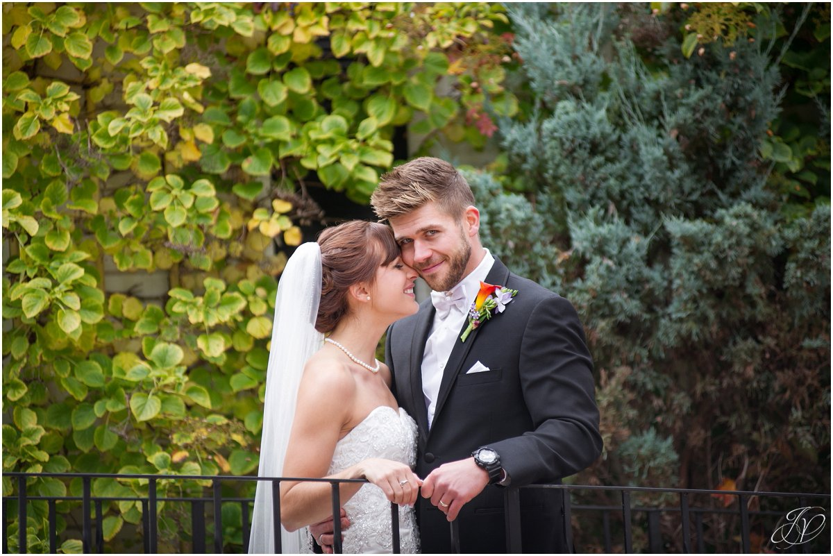 bride nuzzling groom glen sanders mansion wedding