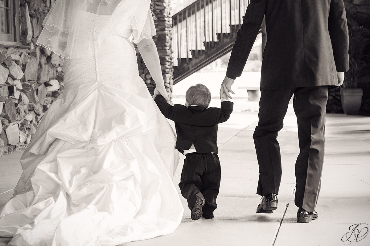sweet photo of son walking with bride and groom