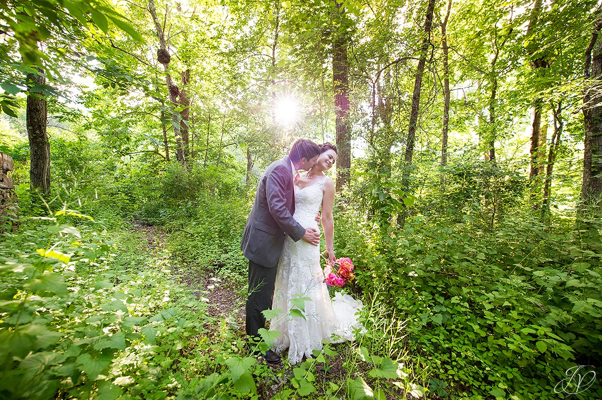 romantic shot of bride and groom, sun flare photo