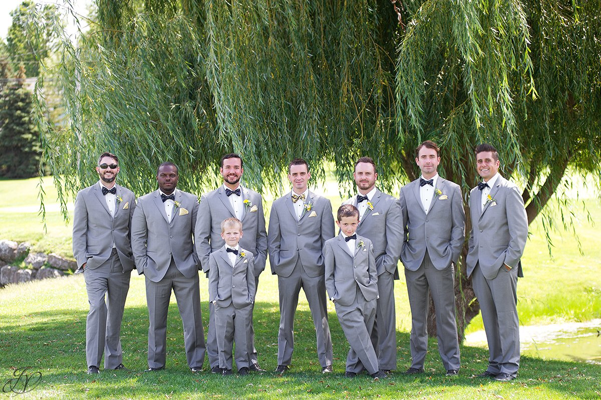 grooms men in bow ties and gray suits