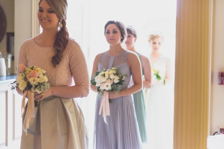 bridesmaids_walking_down_aisle_renaissance_kingston_ont