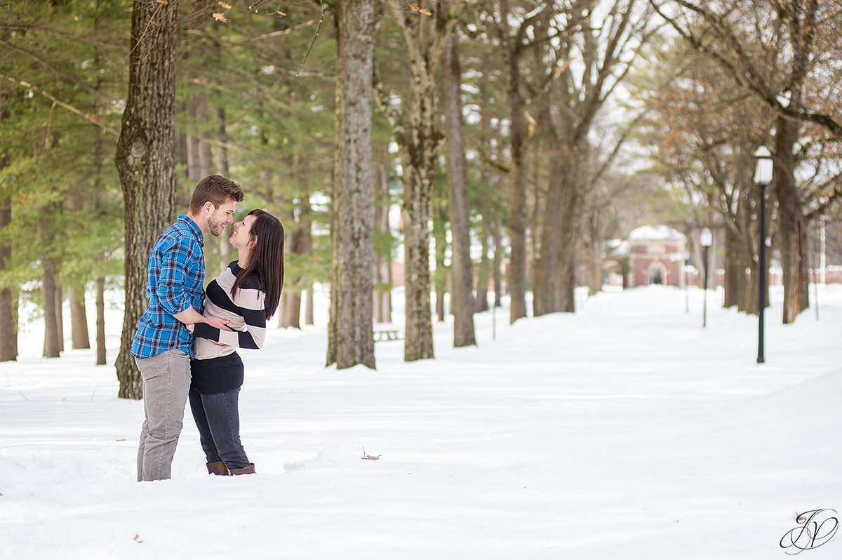 photo of engaged couple in the snow