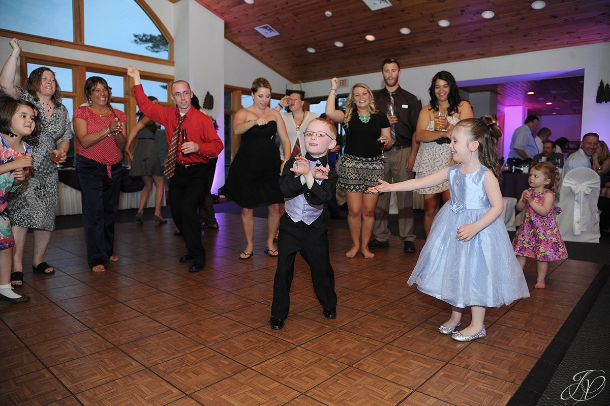 cute photo of kids dancing at wedding reception