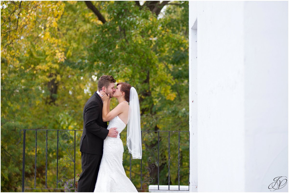 bride and groom kissing scenic fall glen sanders mansion wedding