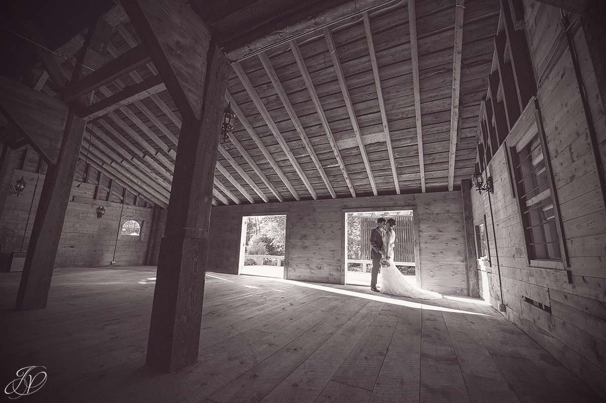 romantic photo of bride and groom in a barn