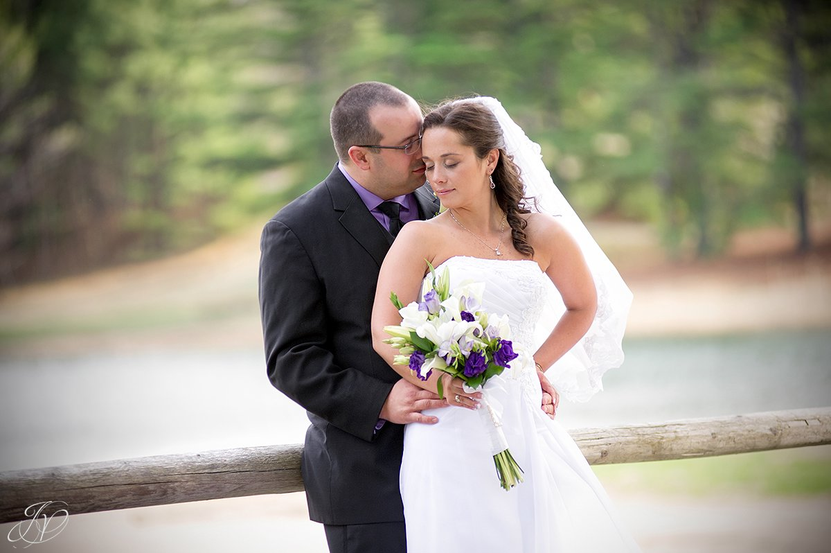 romantic bride and groom kissing photo