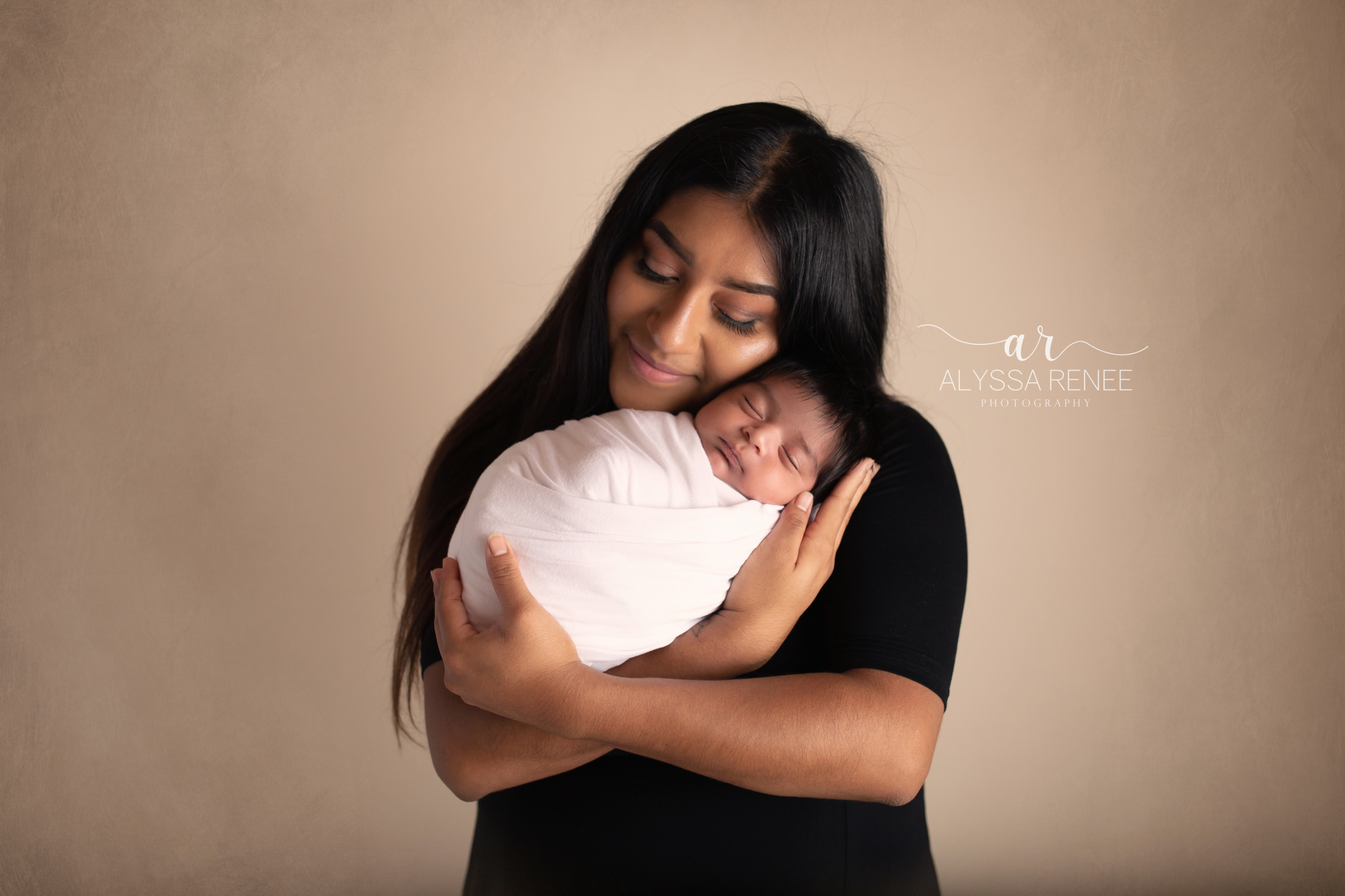 gorgeous mother and baby portrait with brown background taken by alyssa renee photography