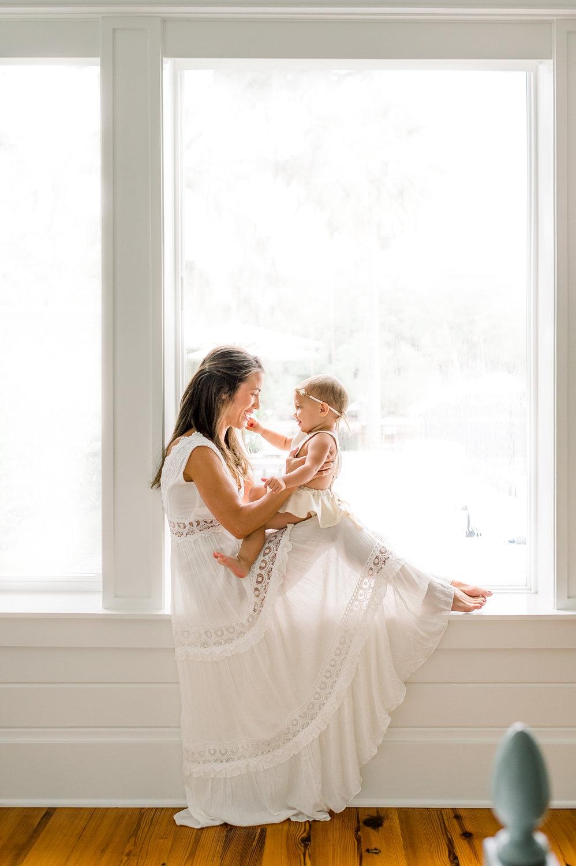 motherhood window portrait, backlit photo of mom and baby, Ryaphotos